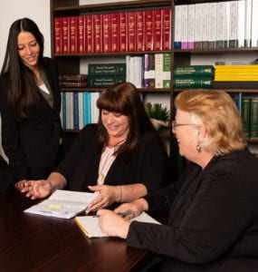 Female veteran disability assistants working together in an office